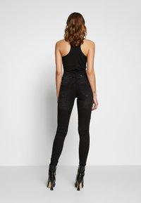 Vero Moda - VMLYDIA LR SKINNY JEANS  - Jeans Skinny Fit - black - 2