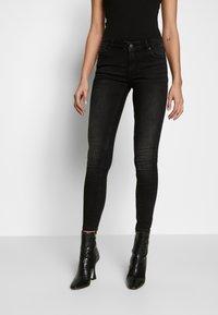 Vero Moda - VMLYDIA LR SKINNY JEANS  - Jeans Skinny Fit - black - 0