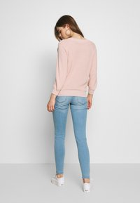 Vero Moda - VMTANYA PIPING - Slim fit jeans - light blue denim - 2