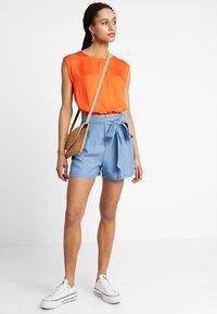 Vero Moda - VMMIA LOOSE SUMMER - Shorts - light blue denim - 1