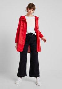 Vero Moda - VMFRIDAY NEW COATED JACKET - Parka - chinese red - 1
