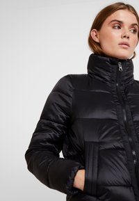 Vero Moda - VMMOLDE JACKET - Winter jacket - black - 4