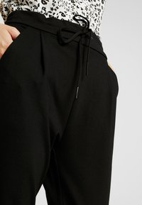 Vero Moda Tall - VMEVA LOOSE STRING PANTS  - Joggebukse - black - 5