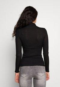 Vero Moda Tall - VMOPHELIA HIGHNECK FRILL - Jumper - black - 2