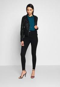 Vero Moda Tall - SHORT JACKET - Imitert skinnjakke - black - 1