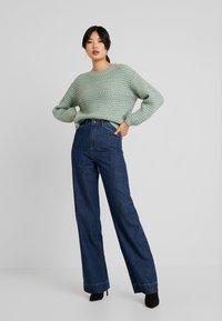 Vero Moda Tall - VMKATHY HERONA WIDE - Flared jeans - dark blue denim - 1