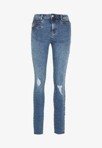 Vero Moda Tall - VMSEVEN SLIM ZIP ANK JEANS - Skinny džíny - medium blue - 0