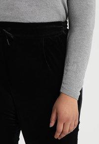 Vero Moda Curve - VMEVA STRING PANT  - Verryttelyhousut - black - 4