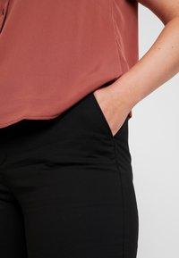 Vero Moda Curve - Trousers - black - 4