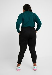 Vero Moda Curve - Trousers - black