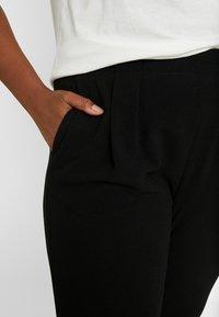 Vero Moda Curve - Pantalones - black - 5