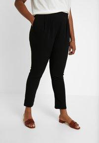 Vero Moda Curve - Pantalones - black - 0