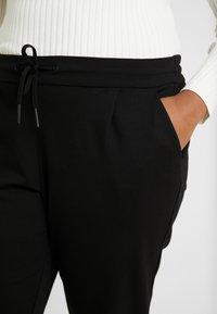 Vero Moda Curve - VMEVA STRING CURVE - Pantalones deportivos - black - 4