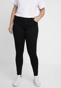 Vero Moda Curve - Slim fit jeans - black - 0