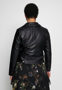 Vero Moda Curve - VMULTRAMALOU SHORT COATED JACKET - Faux leather jacket - black - 2