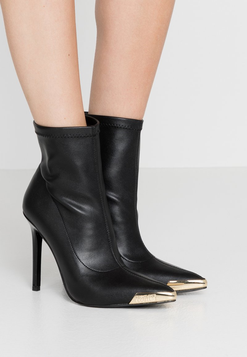 Versace Jeans Couture - High heeled ankle boots - nero