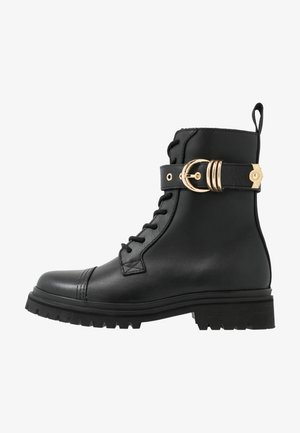 Lace-up ankle boots - nero