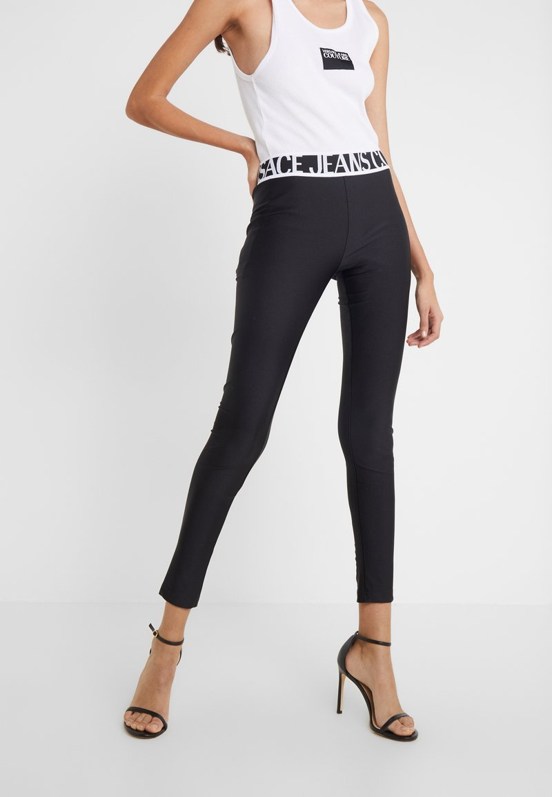 Versace Jeans Couture - LADY FUSEAUX - Leggings - Trousers - nero