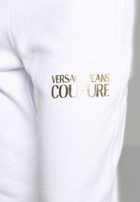 Versace Jeans Couture - LADY TROUSER - Teplákové kalhoty - bianco ottico - 4
