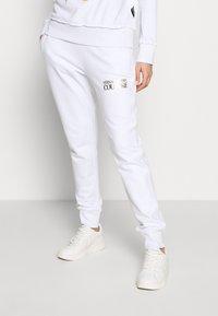 Versace Jeans Couture - LADY TROUSER - Teplákové kalhoty - bianco ottico - 0