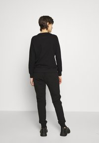 Versace Jeans Couture - LADY TROUSER - Tracksuit bottoms - nero - 2