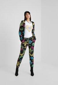 Versace Jeans Couture - Sudadera con cremallera - black - 1