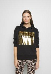 Versace Jeans Couture - LADY LIGHT SWEATER - Felpa con cappuccio - black - 0