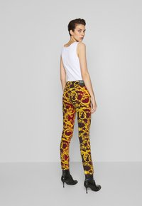 Versace Jeans Couture - LADY TROUSER - Jeans Skinny Fit - racing red - 2