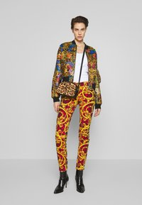 Versace Jeans Couture - LADY TROUSER - Jeans Skinny Fit - racing red - 1