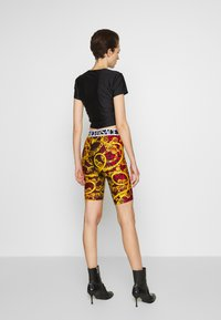 Versace Jeans Couture - LADY FUSEAUX - Shorts - racing red - 2