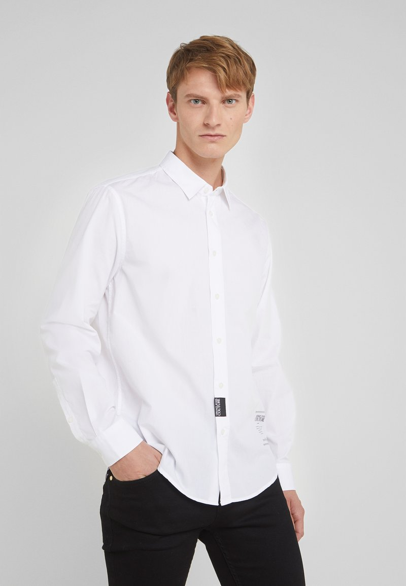 Versace Jeans Couture - CAMICIE  - Shirt - bianco ottico