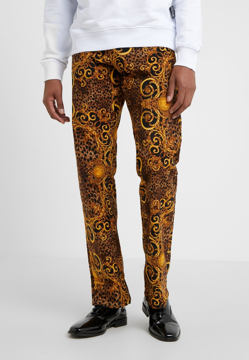 Versace Jeans Couture - PANTALONI UOMO - Tygbyxor - gold