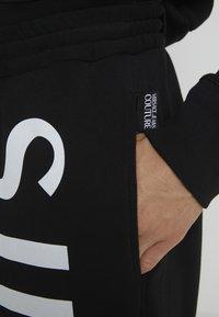Versace Jeans Couture - JOGGERS - Pantalon de survêtement - black - 5