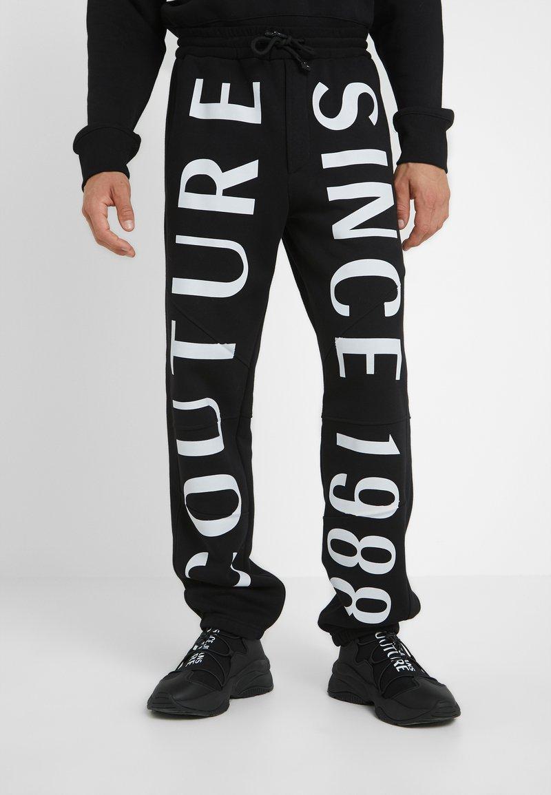 Versace Jeans Couture - JOGGERS - Pantalon de survêtement - black