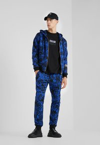 Versace Jeans Couture - BAROQUE - Tracksuit bottoms - dark blue - 1