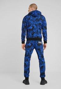 Versace Jeans Couture - BAROQUE - Tracksuit bottoms - dark blue - 2