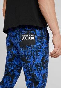 Versace Jeans Couture - BAROQUE - Tracksuit bottoms - dark blue - 3