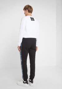 Versace Jeans Couture - PANTALONI - Tracksuit bottoms - nero - 2