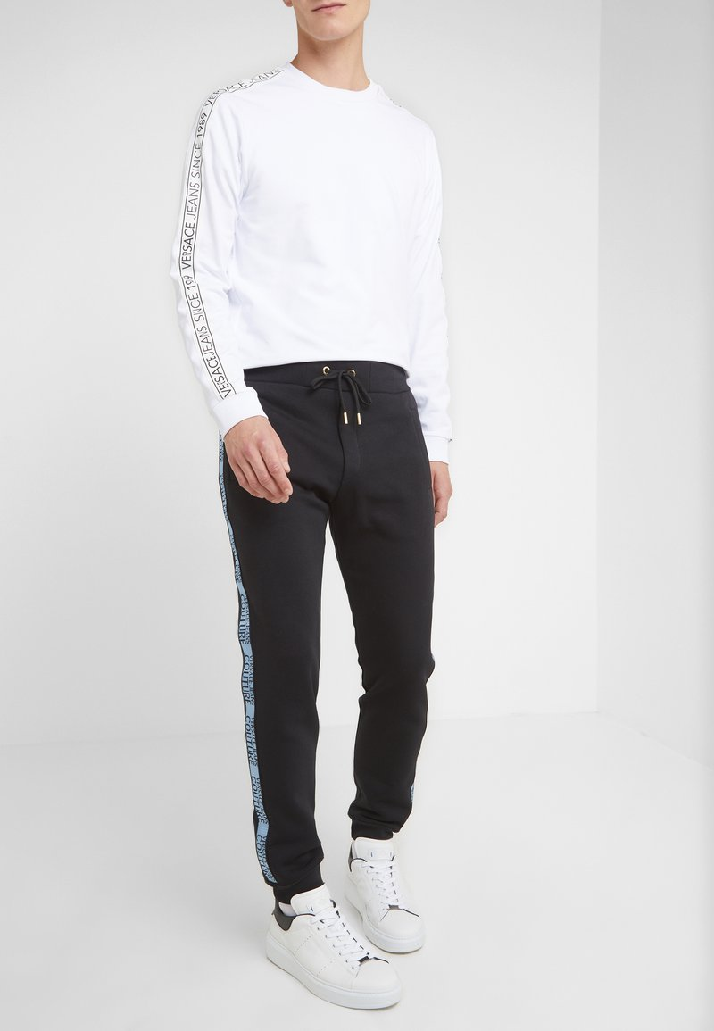 Versace Jeans Couture - PANTALONI - Träningsbyxor - nero