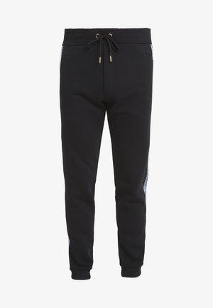 PANTALONI - Pantalon de survêtement - nero