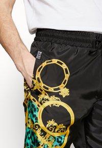 Versace Jeans Couture - TRACK PANTS - Verryttelyhousut - pure mint - 4