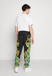 Versace Jeans Couture - TRACK PANTS - Verryttelyhousut - pure mint - 2