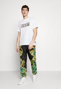 Versace Jeans Couture - TRACK PANTS - Verryttelyhousut - pure mint - 1