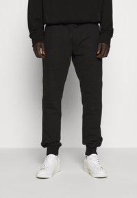 Versace Jeans Couture - BASIC JOGGERS - Spodnie treningowe - black - 0