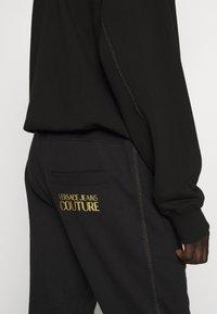 Versace Jeans Couture - BASIC JOGGERS - Spodnie treningowe - black - 5