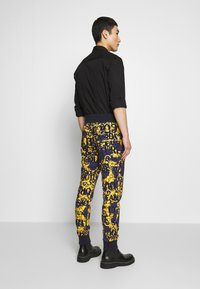 Versace Jeans Couture - ALLOVER PRINT JOGGERS - Trainingsbroek - blue - 2