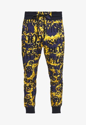 ALLOVER PRINT JOGGERS - Tracksuit bottoms - blue