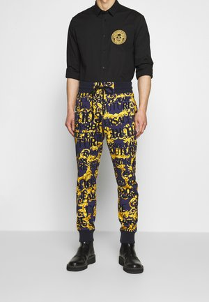 ALLOVER PRINT JOGGERS - Pantalon de survêtement - blue