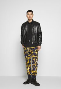 Versace Jeans Couture - ALLOVER PRINT JOGGERS - Trainingsbroek - blue - 1