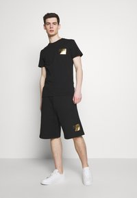 Versace Jeans Couture - Trainingsbroek - black - 1